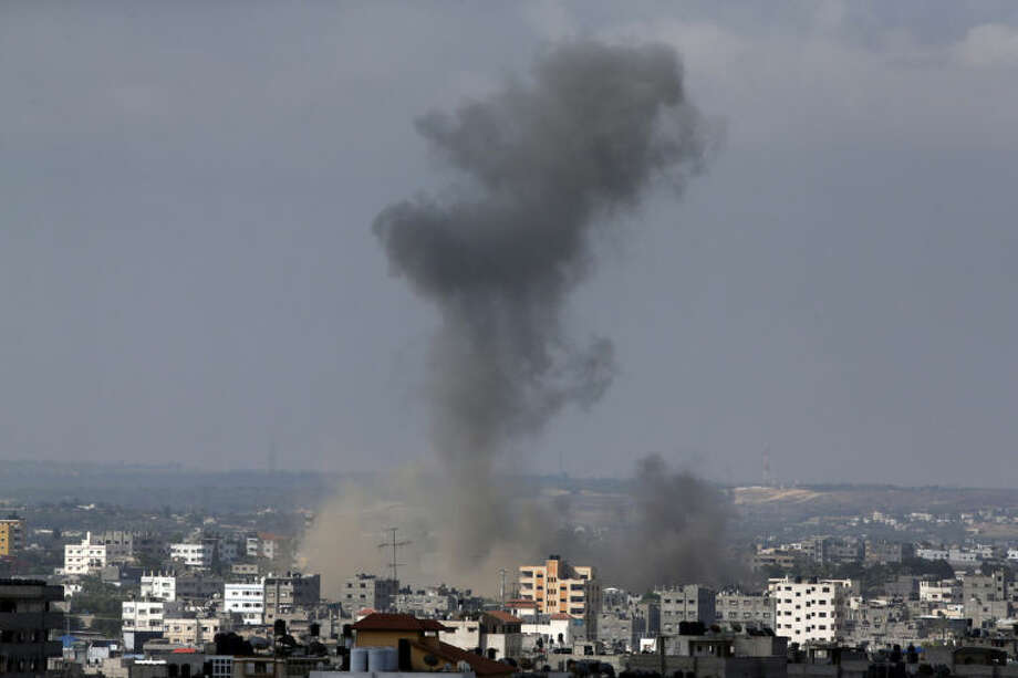 Smoke rises after an Israeli missile strike in Gaza City, northern Gaza Strip, Friday, July 18, 2014. Israel intensified its 11-day campaign against Hamas by sending in tanks and troops late Thursday after becoming increasingly exasperated with unrelenting rocket fire from Gaza on its cities, especially following Hamas' rejection of an Egyptian cease-fire plan earlier in the week.(AP Photo/Lefteris Pitarakis)