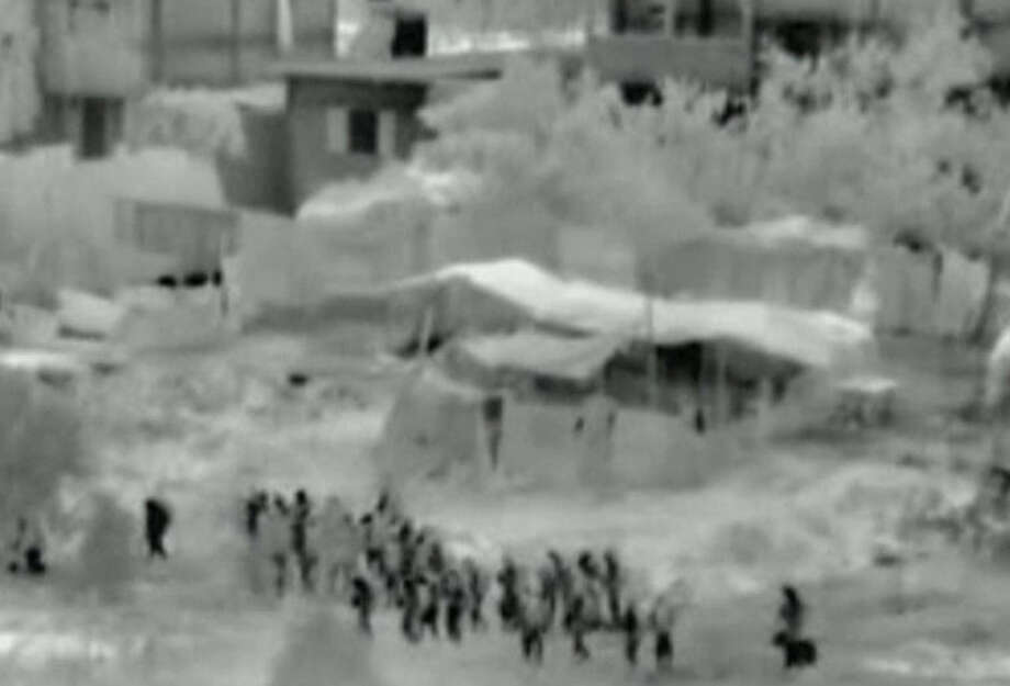 This image made from video released by the Israeli military on Friday, July 18, 2014 shows troops after crossing into the Gaza Strip at the beginning of a ground offensive Thursday, July 17, 2014. Israeli troops pushed deeper into Gaza on Friday to destroy rocket launching sites and tunnels, firing volleys of tank shells and clashing with Palestinian fighters in a high-stakes ground offensive meant to weaken the enclave's Hamas rulers. (AP Photo/Israeli Defense Forces via AP video)