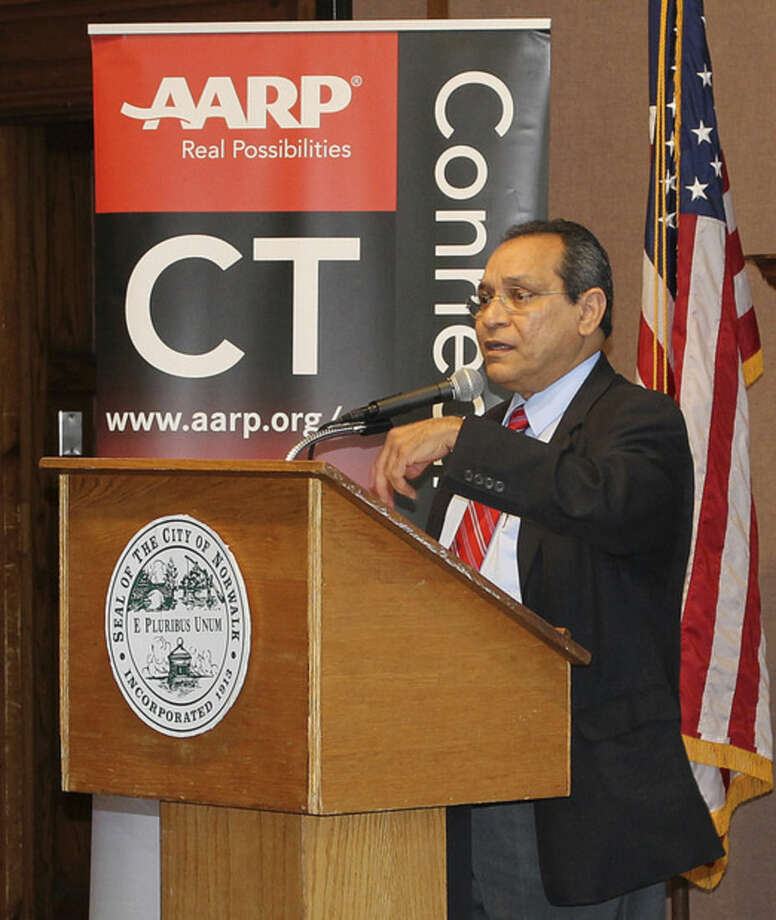 Hour Photo/ Rachel SawyerJulio Casiano of the Small Business Administration speaks at the AARP and SBA event.