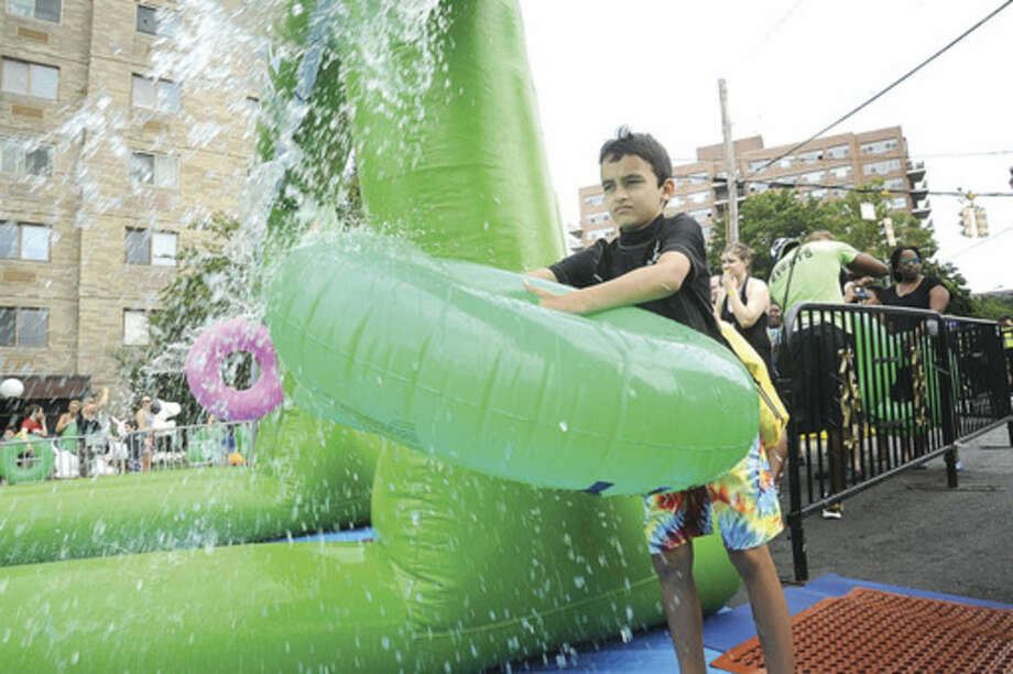 Ajay Bagaria 9, gets ready for the ride on the giant water slide at the Slide City event held in downtown Stamford. Hour photo/Matthew Vinci