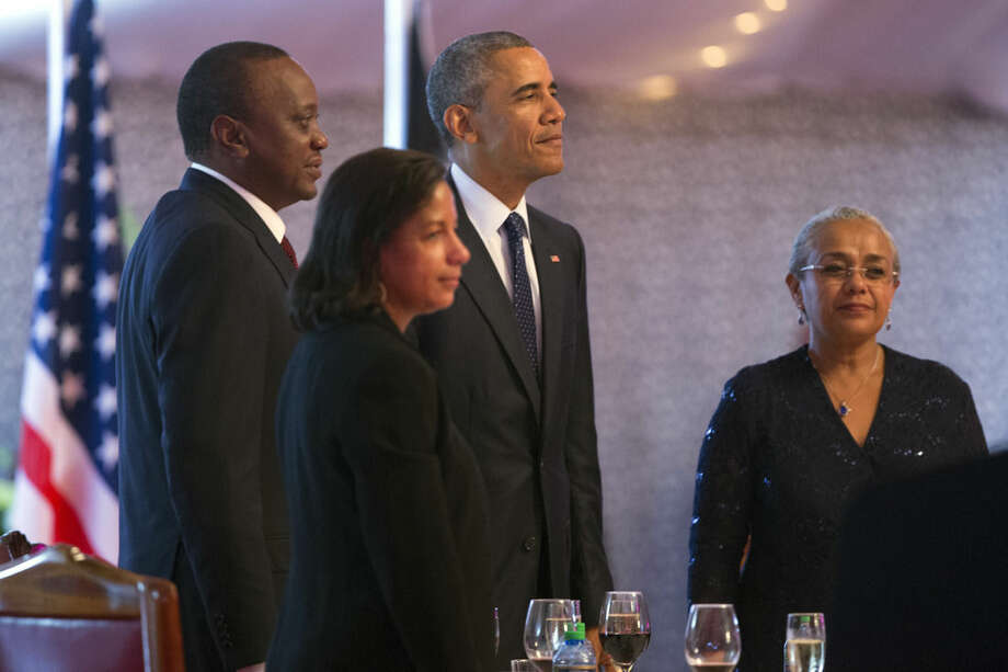 President Barack Obama, third from left, stands before the playing of the National Anthem during a state dinner at State House, on Saturday, July 25, 2015, in Nairobi, Kenya. Obama's visit to Kenya is focused on trade and economic issues, as well as security and counterterrorism cooperation. From left, Kenyan President Uhuru Kenyatta, National Security Adviser Susan Rice, Obama, and Kenyan first lady Margaret Kenyatta. (AP Photo/Evan Vucci)
