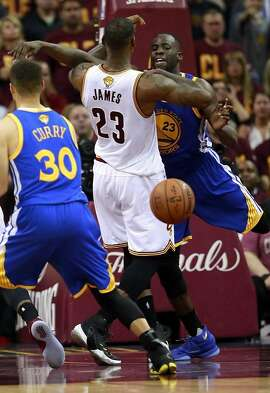 Cavaliers' LeBron James and  the Warriors' Draymond Green get tangled up under the basket  which led to an exchange of words in the fourth quarter, as the Golden State Warriors went on to beat the Cleveland Cavalier108-97 in game 4 of  the NBA Championship at Quicken Loans Arena in Cleveland, Ohio on Fri. June 10, 2016.