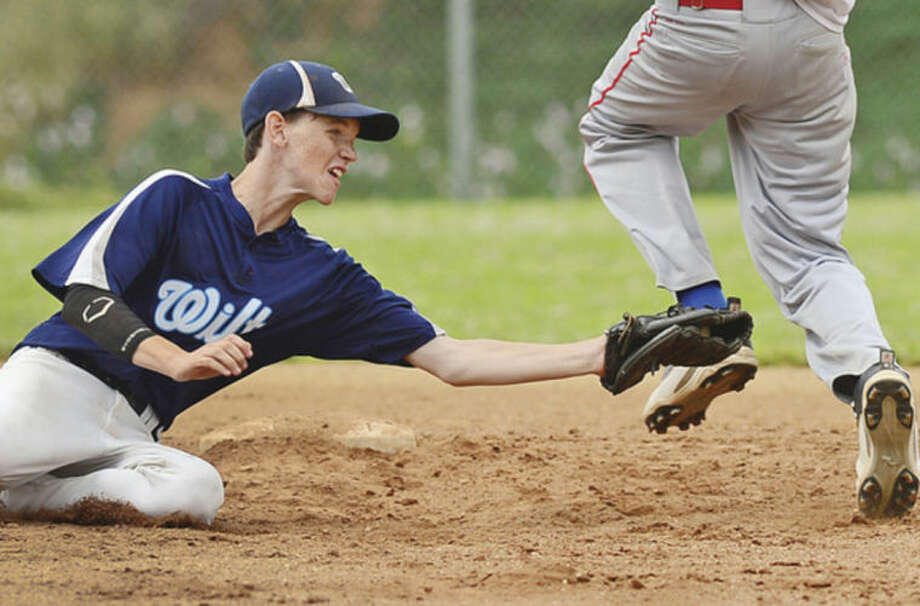 Hour photo/Erik TrautmannWilton second baseman Chris Tienkan tries to put the tag on a Pomperaug runner in their Babe Ruth State Tournament Semifinal game at Brien McMahon High School Saturday.