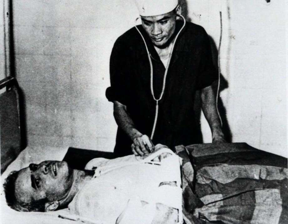 """FILE - In this fall 1967 file photo, John McCain is administered to at a Hanoi, Vietnam hospital as a prisoner of war. Republican presidential candidate Donald Trump criticized Sen. John McCain's military record at a conservative forum Saturday, saying the party's 2008 nominee and former prisoner of war was a """"war hero because he was captured. I like people who weren't captured."""" McCain spent 20 years in the Navy, a quarter of it in a Vietnamese prisoner of war camp after his jet was shot down over Hanoi during a bombing mission Oct. 26, 1967. (AP Photo/File)"""