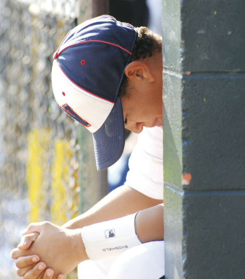 Hour photo/John NashNorwalk Little League All-Star Randy Mateo reacts while sitting on the edge of his team's dugout after Fairfield American bested his 12-year-old All-Stars 10-7 in the Section 1/Division 1 championship game in Orange.