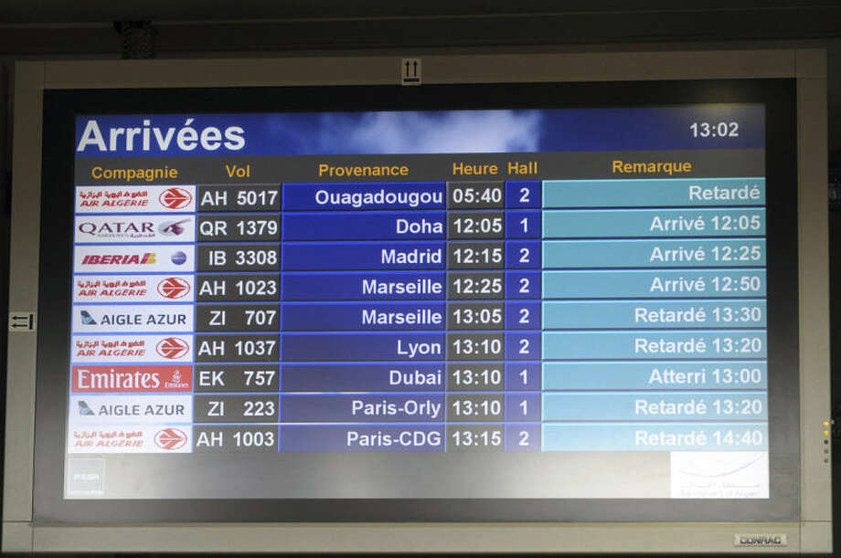 """An arrival information screen shows the delayed Air Algerie flight 5017 (top) at the Houari Boumediene airport near Algiers, Algeria, Thursday, July 24, 2014. An Air Algerie flight carrying 116 people from Burkina Faso to Algeria's capital disappeared from radar early Thursday over northern Mali and """"probably crashed"""" according to the plane's owner and government officials in France and Burkina Faso. (AP Photo/Sidali Djarboub)"""