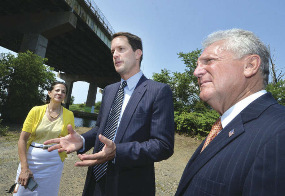 Hour Photo/Alex von Kleydorff Congressman Jim Himes, Mayor Harry Rilling and State Rep Gail Lavielle talk about the need for long-term investments in federal transportation infrastructure and the repairs needed for the I95 Yankee Doodle Bridge over the Norwalk River