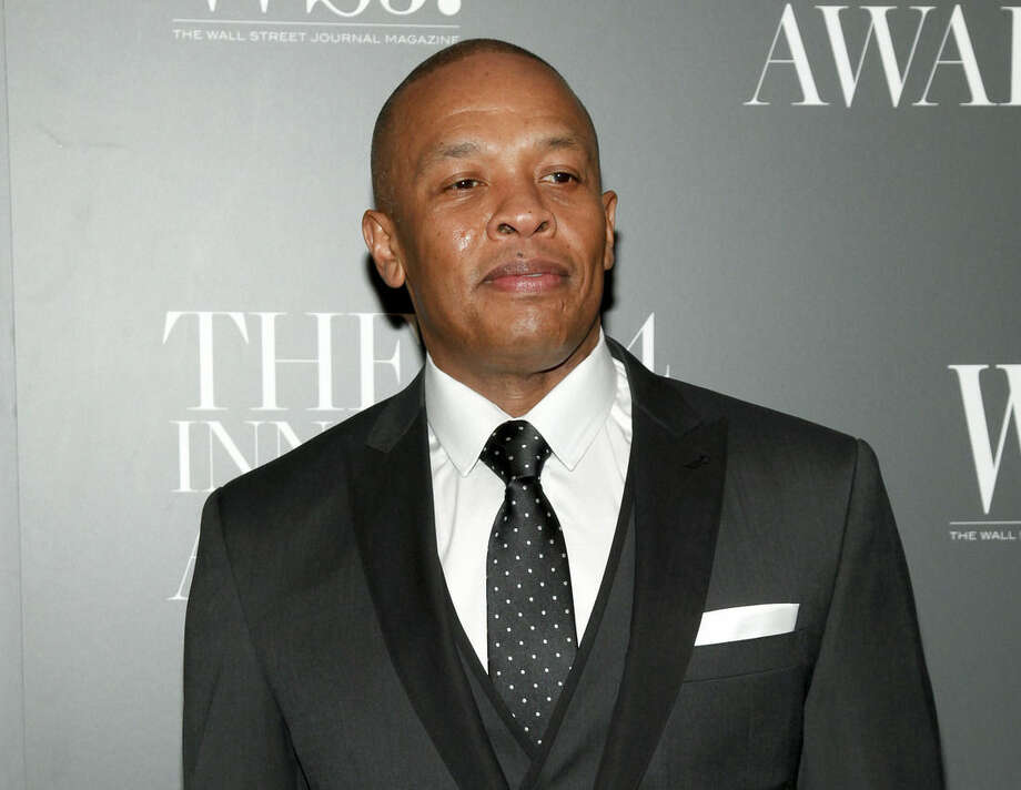 FILE - In this Nov. 5, 2014 file photo, Dr. Dre attends the WSJ. Magazine 2014 Innovator Awards at MoMA in New York. When the world first heard the names Ice Cube and Dr. Dre, the young musicians were considered outlaws as members of rap group N.W.A. Now they're mainstream entertainment icons, reflecting changes in the two artists and in popular culture. (Photo by Andy Kropa/Invision/AP, File)