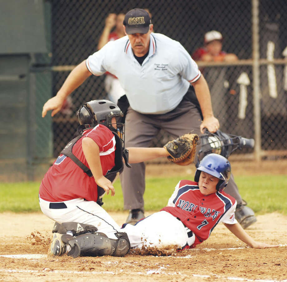 Hour photo/John NashNorwalk's Jack Mathews, right, slides under the tag of Annex catcher Gianni DeMartino during the bottom of the fifth inning of Wednesday's Section 1/Division 1 tournament opener in Orange.
