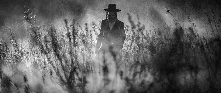 Haim-Aron (Aharon Traitel), a Hasidic yeshiva student in Jerusalem, has a  crisis of faith in �Tikkun.� CAPTION