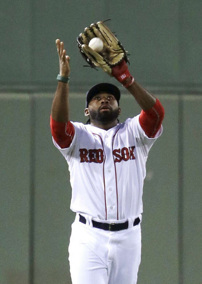 Boston Red Sox center fielder Jackie Bradley Jr. catches a fly ball hit by New York Yankees' Jacoby Ellsbury in the first inning of a baseball game, in Boston, Sunday, Aug. 3, 2014. (AP Photo/Steven Senne)
