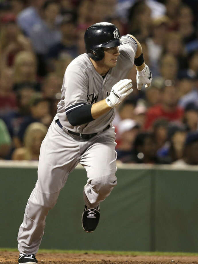 New York Yankees' Stephen Drew runs toward first base after grounding into a fielder's choice allowing Yankees' Mark Teixeira to score in the second inning of a baseball game against the Boston Red Sox, in Boston, Sunday, Aug. 3, 2014. (AP Photo/Steven Senne)