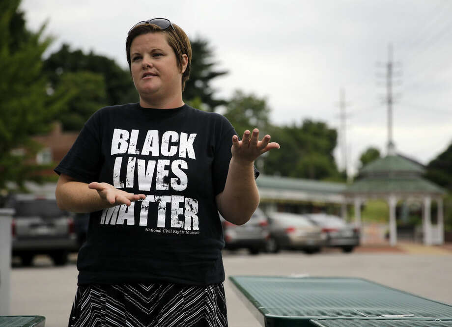 """In this July 22, 2015, Emily Davis speaks during an interview in Ferguson, Mo. Davis said she has seen little change for the better in the past year. """"People are still being targeted by police officers,"""" Davis said. """"If you talk to people who live on West Florissant, that is still happening. Our city government has not become any more communicative. They have not made any attempt to engage in dialogue _ meaningful dialogue _ with the citizens, which is not any different than it was a year ago."""" (AP Photo/Jeff Roberson)"""