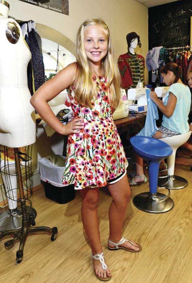 Anna Hoffman models a dress she made.