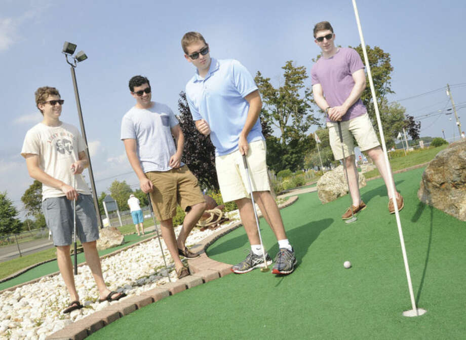 Hour photos/Matthew VinciAbove, from left, Andrew Accardi 's friends, who were his Staples High School classmates as well as the organizers: Sam Bender, Matt Labarie, Ethan Tassel and Brett Adelglass at the miniature golf course at Norwalk Cove Marina.