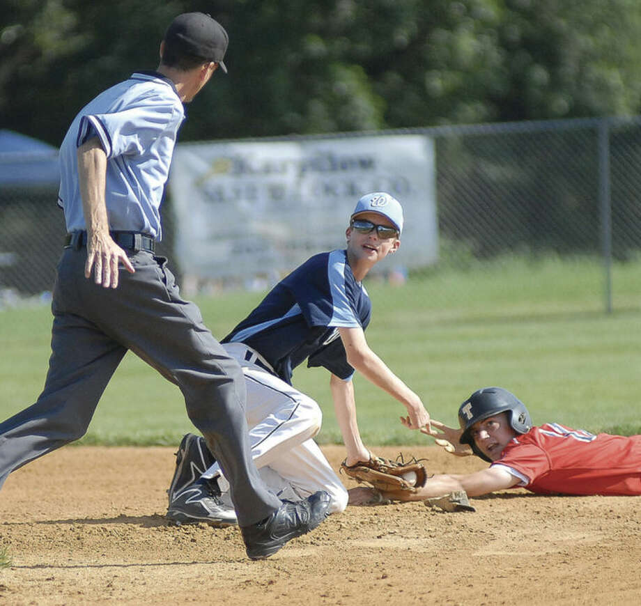 Hour photo/John NashWilton Junior Legion second baseman Ryan Osgood, center, gestures toward the umpire during Monday's state tournament game in Trumbull. Wilton stunned Trumbull, the Zone 4 regular season champs, with a 3-0 win.