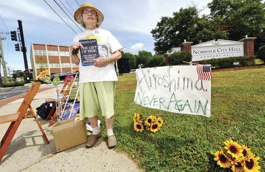 Hour photo / Erik TrautmannMissy Conrad of the Connecticut Friends (Quakers) holds vigil outside of City Hall to protest the use of nuclear weapons on the 70th anniversary of the Aug. 6, 1945, atomic bombing of Hiroshima.