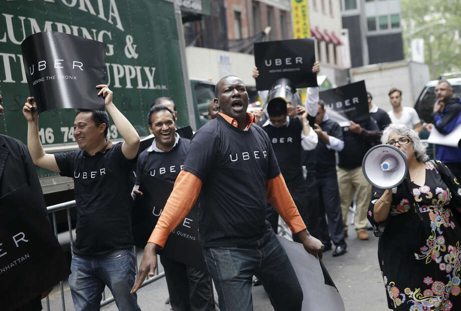 FILE - In this May 28, 2015, file photo, Uber drivers and their supporters protest in front of the offices of the Taxi and Limousine Commission in New York. In four years Uber has gone from nearly non-existent to more than 26,000 drivers, joining over 13,000 New York City taxis. (AP Photo/Seth Wenig, File)