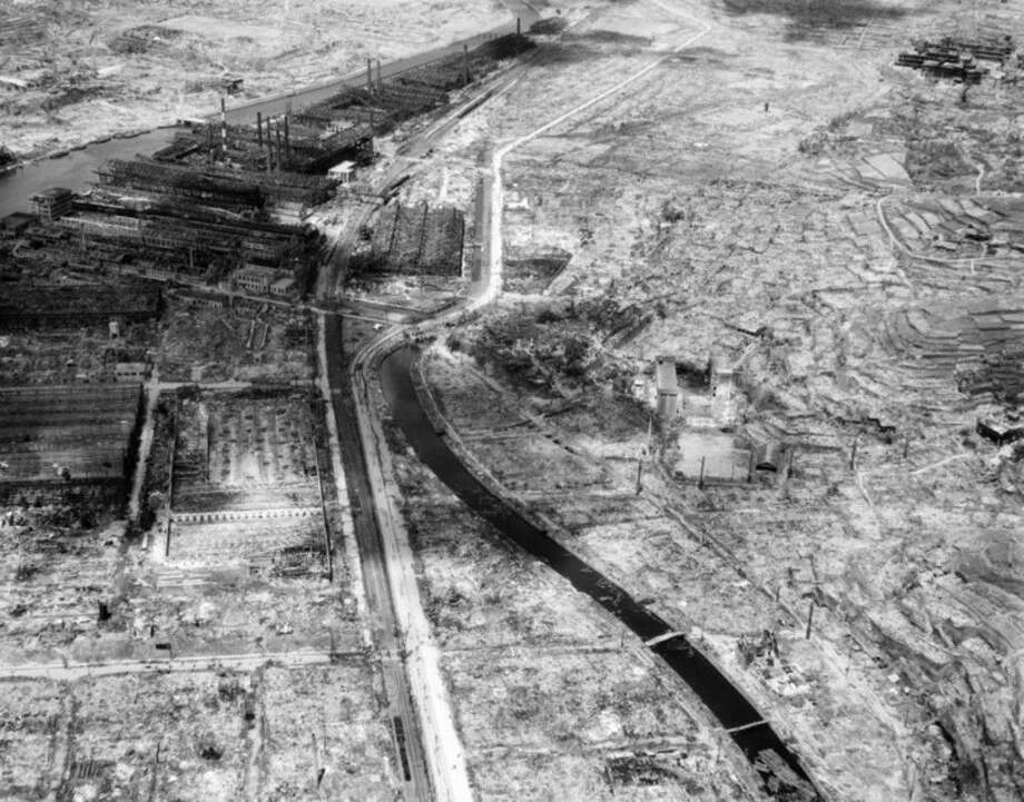 FILE - In this Sept. 4, 1945 file photo, the remains of a factory are seen, upper left, in the southern Japanese city of Nagasaki, gutted by the Aug. 9 atomic bombing. On two days in August 1945, U.S. planes dropped two atomic bombs, one on Hiroshima, one on Nagasaki, the first and only time nuclear weapons have been used. Their destructive power was unprecedented, incinerating buildings and people, and leaving lifelong scars on survivors, not just physical but also psychological, and on the cities themselves. Days later, World War II was over. (AP Photo/File)