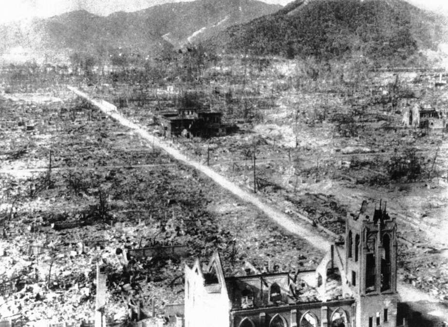 FILE- In this Sept. 5, 1945, file photo, the skeleton of a Catholic Church, foreground, and an unidentified building, center, are all that remaining the blast center area after the atomic bomb of Hiroshima, Japan. On two days in August 1945, U.S. planes dropped two atomic bombs, one on Hiroshima, one on Nagasaki, the first and only time nuclear weapons have been used. Their destructive power was unprecedented, incinerating buildings and people, and leaving lifelong scars on survivors, not just physical but also psychological, and on the cities themselves. Days later, World War II was over. (AP Photo, File)