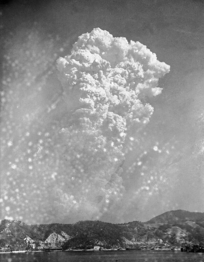 FILE- In this Aug. 6, 1945, file photo, smoke rises 20,000 feet above Hiroshima, Japan, after the first atomic bomb was dropped. On two days in August 1945, U.S. planes dropped two atomic bombs, one on Hiroshima, one on Nagasaki, the first and only time nuclear weapons have been used. Their destructive power was unprecedented, incinerating buildings and people, and leaving lifelong scars on survivors, not just physical but also psychological, and on the cities themselves. Days later, World War II was over. (AP Photo, File)