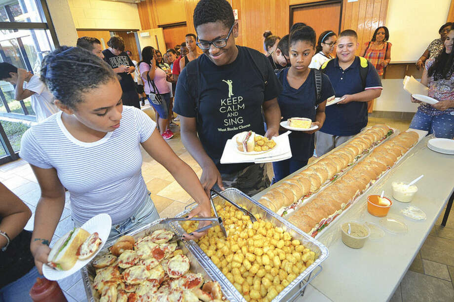 Hour Photo/Alex von Kleydorff Incoming freshna at Norwalk high enjoy 6ft subs and a catered lunch on the last day of the Freshman Academy program