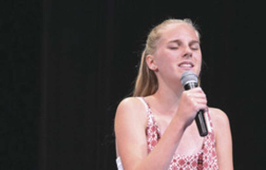 Hour photo/Alex von KleydorffCharlotte Baekey sings during Norwalk High School Annual PF Camp Talent Show.