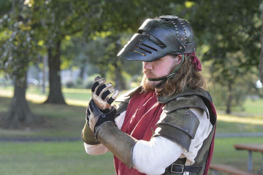 Hour Photo/Alex von Kleydorff Tim Smith gets ready for battle as Bro'gar and suits up in period correct garb, for Full Contact Medieval Warfare with Fairfield County Dagorhir as they train at Mathews Park in Norwalk on Wenesday
