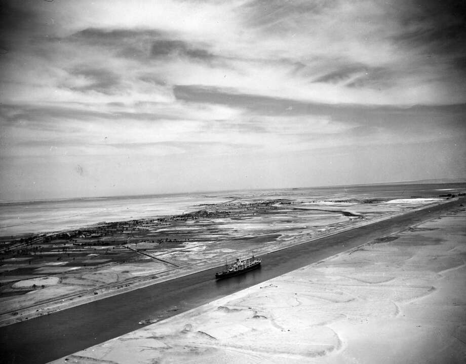 FILE - This May 26, 1953 file photo shows an aerial view of the Suez Canal Zone near Ismailia, Egypt. The 1869 inauguration of the canal linking the Red Sea to the Mediterranean was hailed as a leap into the modern age, and President Gamal Abdel-Nasser's nationalization of the British and French-run waterway in 1956 is seen as marking Egypt's decisive break with its colonial past. The government hopes for another historic moment Thursday, Aug. 6, 2015 when it unveils an $8.5 billion extension of the waterway funded entirely by Egyptians, without foreign aid. (AP Photo/Jim Pringle, File)