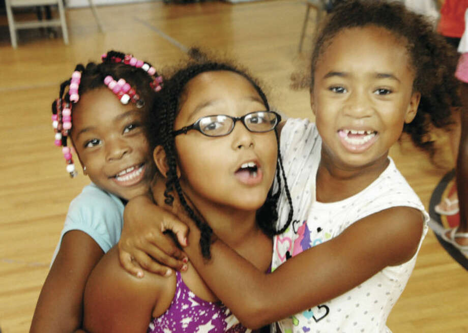 Hour photo/Matthew VinciZariyah Smith, 5, Iyahnie Robinson, 8, and Serinity Samuels, 7, enjoy the Roodner Court Family Fun Day held in the Ely Gymnasium Saturday afternoon.