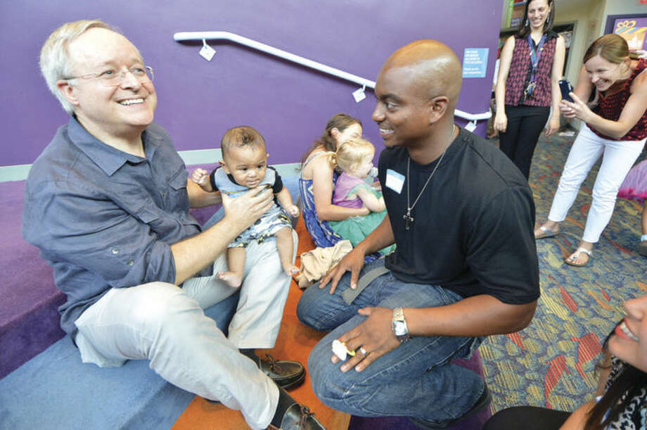 Hour Photo/Alex von Kleydorff Isiash Coobs and his 5 Month old son Dorian get to say hi to his former doctor, Neonatalologist James Belisle, who was honored during the Norwalk Hospital NICU Reunion party at Stepping Stones Musem for Children