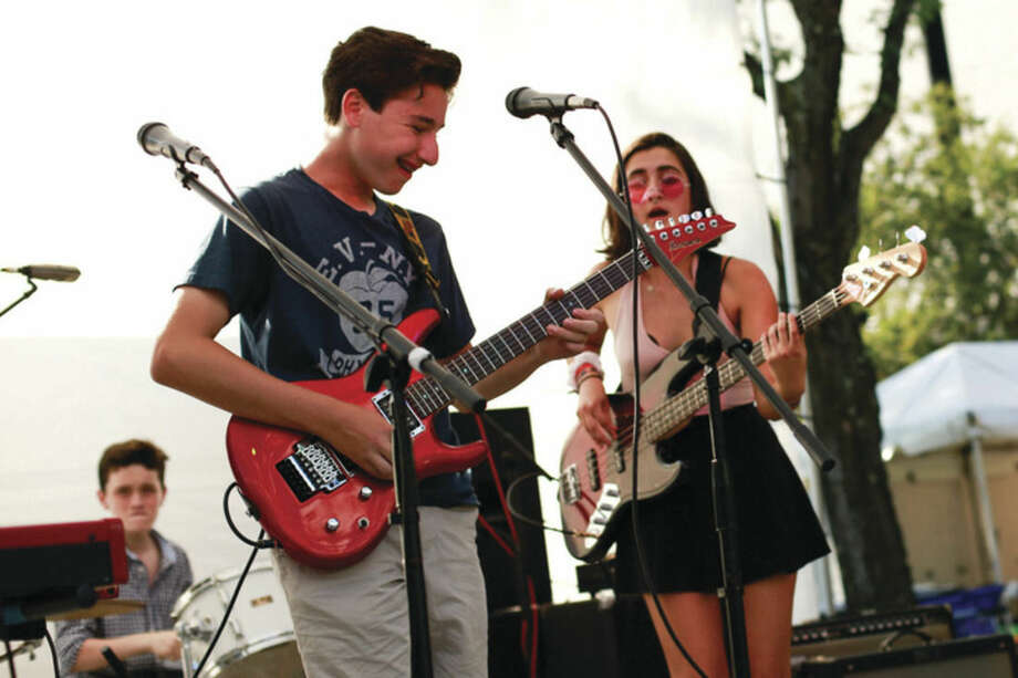 Hour photo/Chris PalermoFairfield School of Rock students perform at the SoNO Arts Festival Saturday afternoon.