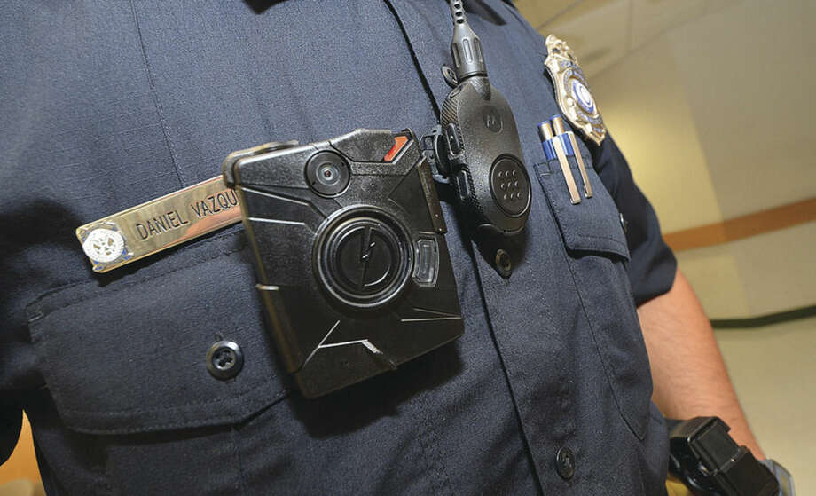 Hour Photo/Alex von Kleydorff Police Officer daniel Vazquez with one the citys new body cameras