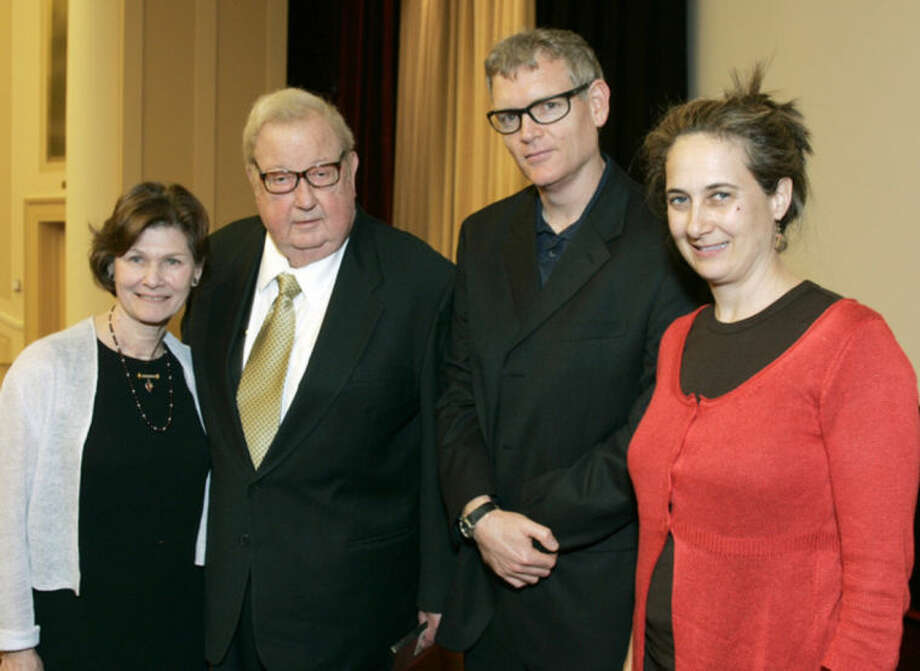 "FILE - In this April 27, 2007 photo provided by the Academy of Motion Picture Arts and Sciences, Anne and Robert Drew, left, join Ed Carter and Grace Guggenheim, right, during an event honoring him at the National Archives in Washington, D.C. The ""cinema verite"" technique and its pioneer, documentary filmmaker Robert Drew, were celebrated by the National Archives and Records Administration and Hollywood's Academy of Motion Picture Arts and Sciences. Drew's eldest son, Thatcher Drew, confirmed that the filmmaker died Wednesday morning, July 30, 2014, at his home in Sharon, Conn. (AP Photo/Neshan Naltchayan, AMPAS)"
