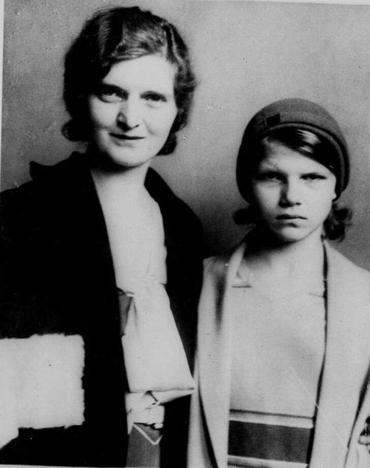 FILE - In this Oct. 28, 1931 file photo, Nan Britton and poses with her daughter, Elizabeth Ann Britton, 12 in Toledo, Ohio. DNA testing is rewriting a chapter in presidential history, this one from the Roaring '20s. AncestryDNA, a division of Ancestry.com, says genetic analysis has confirmed President Warren G. Harding fathered a child out of wedlock with his long-rumored mistress Nan Britton. She set off a scandal when she went public nearly 90 years ago with her tale of forbidden love in the White House. (AP Photo, File)