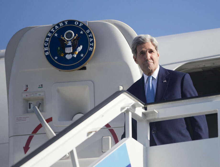 Secretary of State John Kerry arrives at Jose Marti International Airport in Havana, Cuba, Friday, Aug. 14, 2015. Kerry traveled to the Cuban capital to raise the U.S. flag and formally reopen the long-closed U.S. Embassy. Cuba and U.S. officially restored diplomatic relations July 20, as part of efforts to normalize ties between the former Cold War foes. (AP Photo/Pablo Martinez Monsivais, Pool)