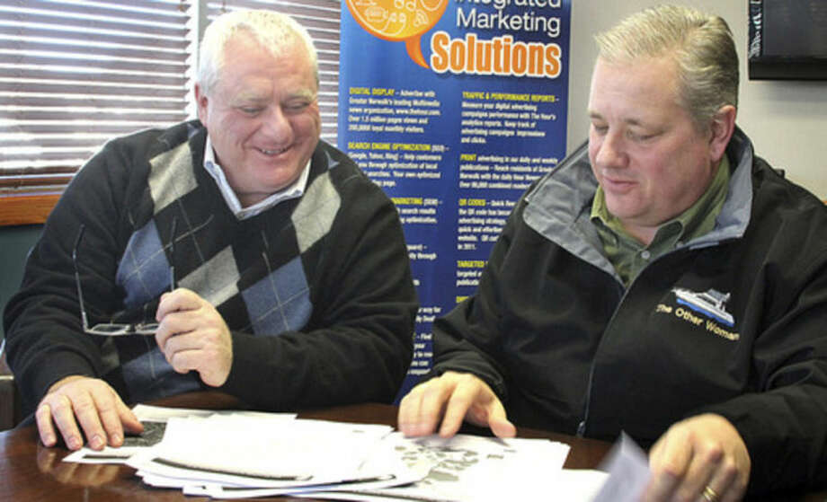 Hour photo / Chris BosakErnie DesRochers, chairman of the Oak Hills Park Authority Driving Range Committee, left, and Clyde Mount, acting chairman of the Oak Hills Park Authority, discuss the Oak Hills Authority Strategic Plan at The Hour offices on Friday.