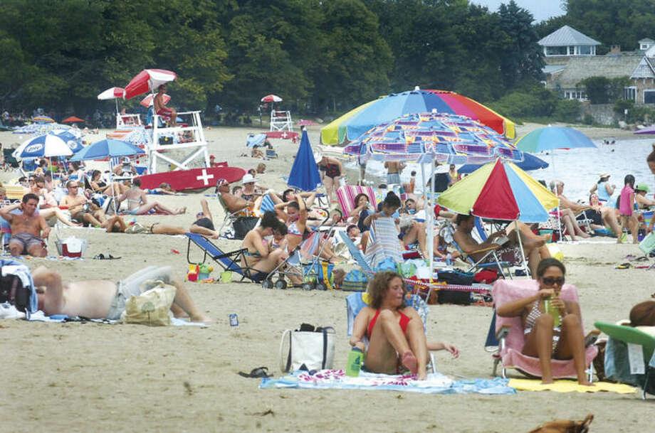 Hour file photo / Alex von KleydorffCrowds pack Calf Pasture beach on a summer day in 2011.