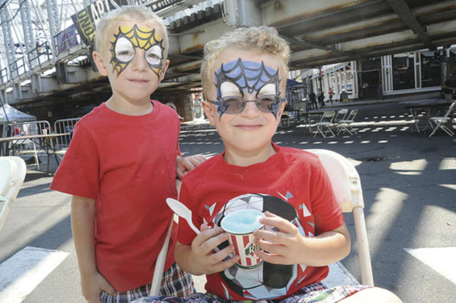 Matthew Winkler, 5, and his brother, Mikey, sport painted faces Sunday at the SoNo Arts Festival.