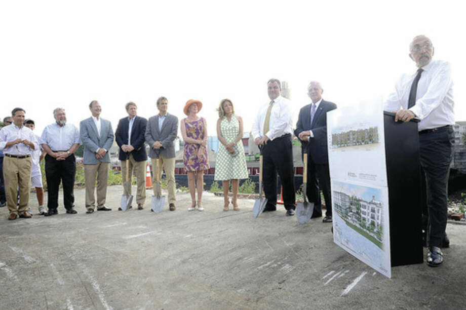 Michael DiScala President and Chief Executive Officer of M.F. DiScala & Company, Incholds a groundbreaking ceremony Monday in the area of the new Head of the Harbor location in Wall Street section of Norwalk. Hour photo/Matthew Vinci