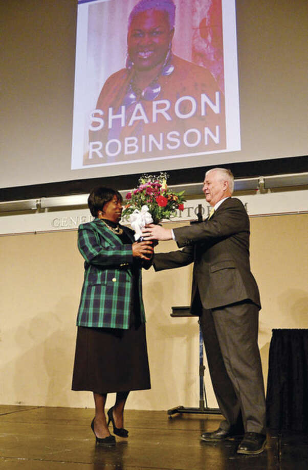 Hour photo / Erik Trautmann Pam Williams, manager of the UCONN-Stamford bookstore, is honored by UCONN president Bill Simpson as The University of Connecticut-Stamford celebrates their 10th annual Black History Month Celebration Thursday.