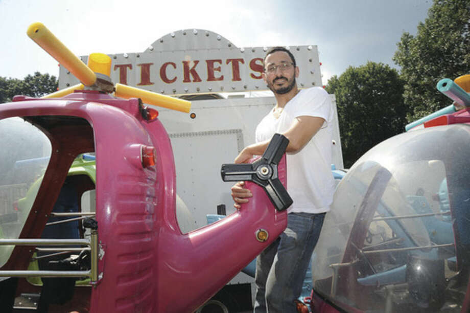 Nick Afentoulides, chairman of the 2015 festival at St. George Greek Orthodox Church, oversees the setup for the festival Wednesday. The St. George Festival, offering rides, food, free admission and free parking, will take place at the church, 238 West Rocks Road, from Thursday to Sunday. Hours are 6 to 10 p.m. on Thursday; 6 to 11 p.m. on Friday; noon to 11 p.m. on Saturday and 1 to 10 p.m. on Sunday.