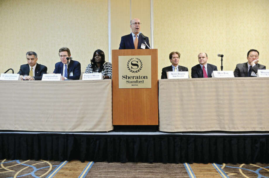 Hour photo / Erik Trautmann AT&T Director of External Affairs, Harry Carey, center, moderates the Stamford Chamber of Commerce 15th annual legislative breakfast at the Sheraton Stamford Hotel Tuesday morning.