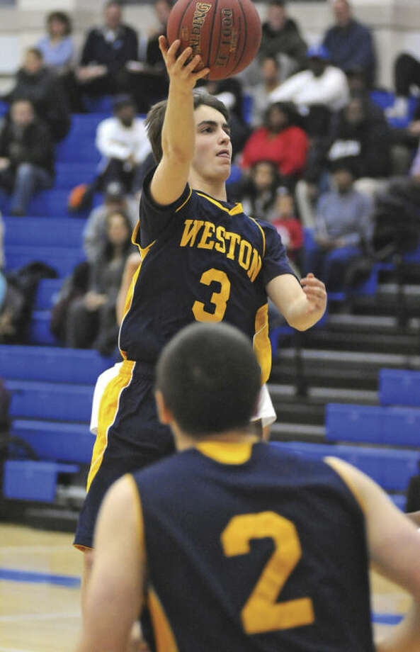 Hour photo/John NashWeston's Julian Bombart (3) puts up a shot as he drives the lane as teammate Brian Cass (2) looks on during Tuesday's SWC semifinal against Bunnell at Newtown High School.