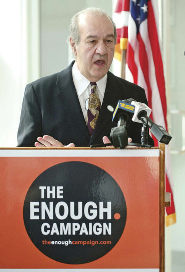 Hour photo / Erik Trautmann ... Connecticut Action Against Gun Violence Executive Director Ron Pinciaro speaks Wednesday at the Stamford Government Center as Stamford Mayor David Martin joins Mayors against Illegal Guns during a ceremony sponsored by The Enough Campaign.