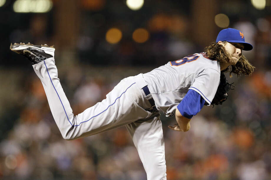 New York Mets starting pitcher Jacob deGrom follows through on a pitch to the Baltimore Orioles in the eighth inning of a baseball game, Tuesday, Aug. 18, 2015, in Baltimore. New York won 5-3. (AP Photo/Patrick Semansky)