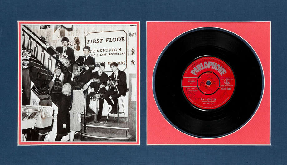 """This undated photo provided by Heritage Auctions from an upcoming Beatles collection sale shows a signed copy of their first hit, """"Love Me Do,"""" which will be auctioned in New York on Sept. 19. The collection, spanning the band's entire career, is from the estate of Uwe Blaschke a noted German Beatles historian who died in 2010. (Heritage Auctions via AP)"""