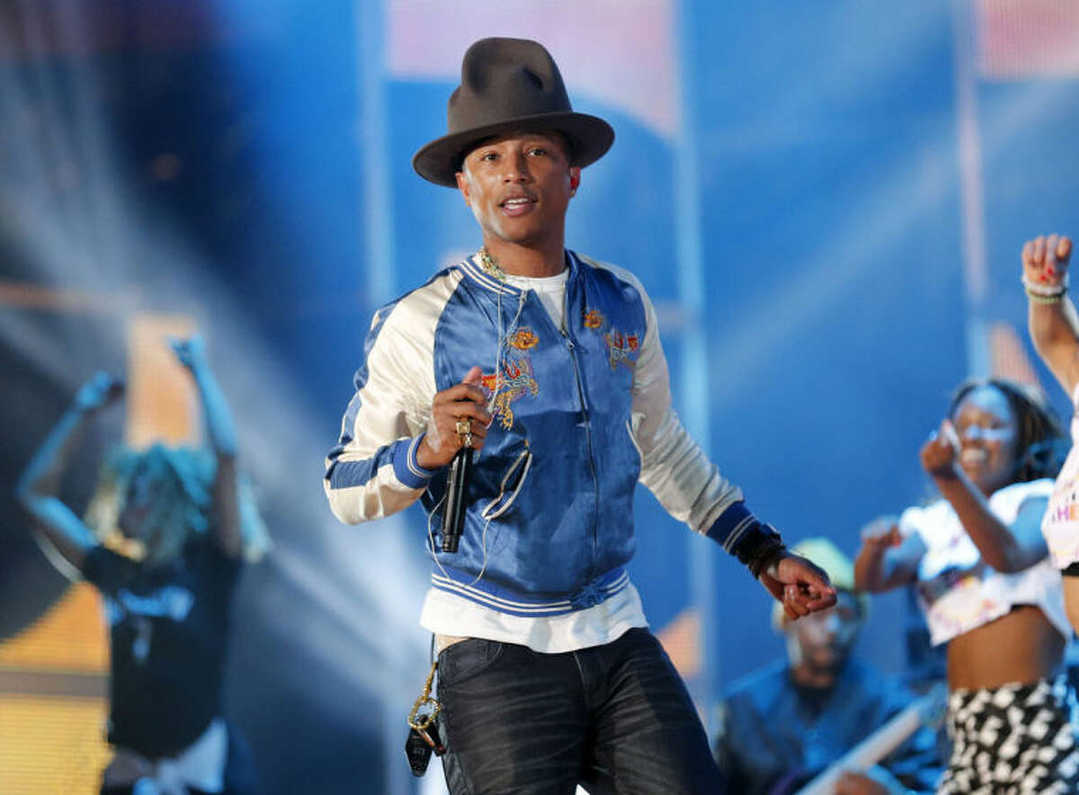 AP Photo/Bill Haber, File This Feb. 16, file photo shows singer-producer Pharrell Williams rehearsing before the NBA All Star basketball game in New Orleans.