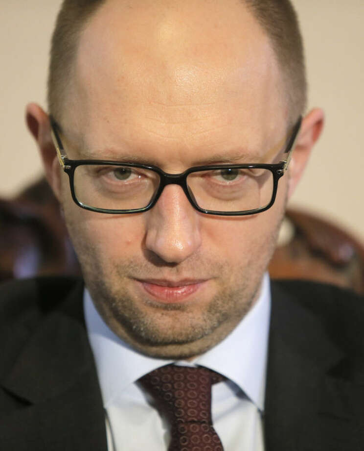AP Photo/Efrem LukatskyUkrainian Prime Minister Arseniy Yatsenyuk talks with reporters during an interview with the Associated Press in Kiev, Ukraine, Wednesday March 5. Yatsenyuk said Wednesday that embattled Crimea must remain part of Ukraine, but may be granted more local powers.