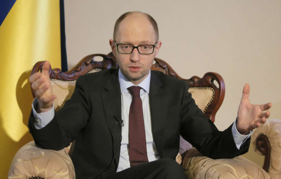 Ukrainian Prime Minister Arseniy Yatsenyuk talks with reporters during an interview with the Associated Press in Kiev, Ukraine, Wednesday, March 5, 2014. Yatsenyuk said Wednesday that embattled Crimea must remain part of Ukraine, but may be granted more local powers. (AP Photo/Efrem Lukatsky)
